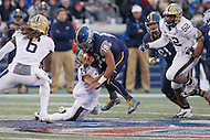Annapolis, MD - December 28, 2015:    Navy Midshipmen quarterback Keenan Reynolds (19) gets tackled by Pittsburgh Panthers defensive back Avonte Maddox (14) during the Military Bowl game between Pitt vs Navy at Navy-Marine Corps Memorial Stadium in Annapolis, MD. (Photo by Elliott Brown/Media Images International)