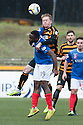 Alloa's Michael Doyle gets a start arm across the face from Cowdenbeath's Kudus Oyenuga as they go for a high ball.