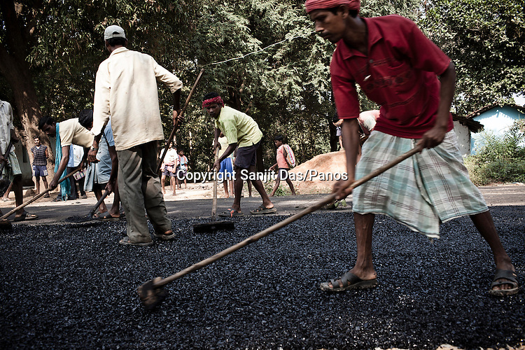 Daily wage labourers work at a road construction site on Bijapur highway in Chhattisgarh, India. Photo: Sanjit Das/Panos
