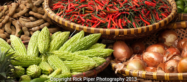 Chillies 05 - Baskets of chillies, bitter melons and tamarinds, Nguyen Thien Thuat St, near Cho Dong Xuan market, Hanoi Old Quarter, Vietnam
