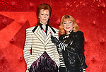 Entertainer Romy Haag poses next to the new wax figure of musician David Bowie at Madame Tussauds in Berlin, Germany, 28 September 2017. Bowie is presented as his alias 'Ziggy Stardust'. Photo: Britta Pedersen/dpa-Zentralbild/dpa