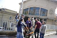 Roma, 31 Ottobre 2011.Sgomberato dalla polizia l'ex deposito ATAC San Paolo di Via Collina Volpi. I locali erano stati occupati da circa 20 famiglie di senzacasa..Recuperati gli oggetti lasciati nele stanze dopo lo sgombero