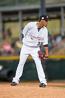 Hickory Crawdads starting pitcher Jonathan Hernandez (33) looks to his catcher for the sign against the Rome Braves at L.P. Frans Stadium on May 12, 2016 in Hickory, North Carolina.  The Braves defeated the Crawdads 3-0.  (Brian Westerholt/Four Seam Images)
