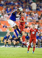 Chris Pontius (13) of D.C. United goes up for a header with Sylvain Distin (15) of Everton during their friendly match held at RFK Stadium in Washington, DC.  D.C. United lost to Everton, 3-1.