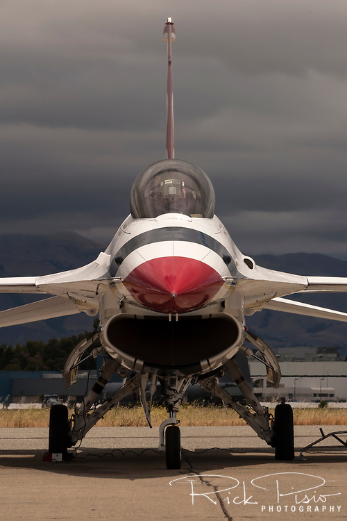 A United States Air Force Thunderbirds F-16 Fighting Falcon sits on the ramp prior to a flight demonstration during the 2004 Moffett Field Airshow in Sunnyvale, California. The Thunderbirds were formed in 1956 and have been flying the F-16C Fighting Falcon since 1992.