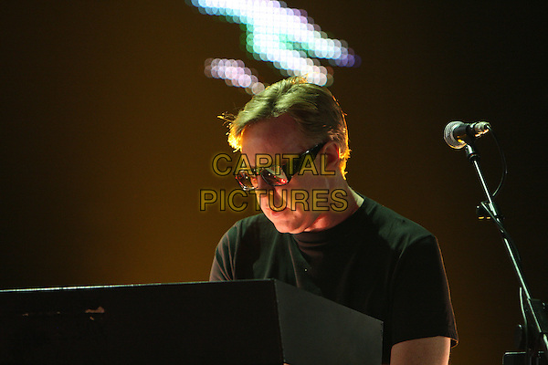 ANDREW FLETCHER of DEPECHE MODE.Performing live at the O2 Arena, London, England..February 20th, 2010.stage concert live gig performance music half length black top glasses piano .CAP/MAR.© Martin Harris/Capital Pictures.