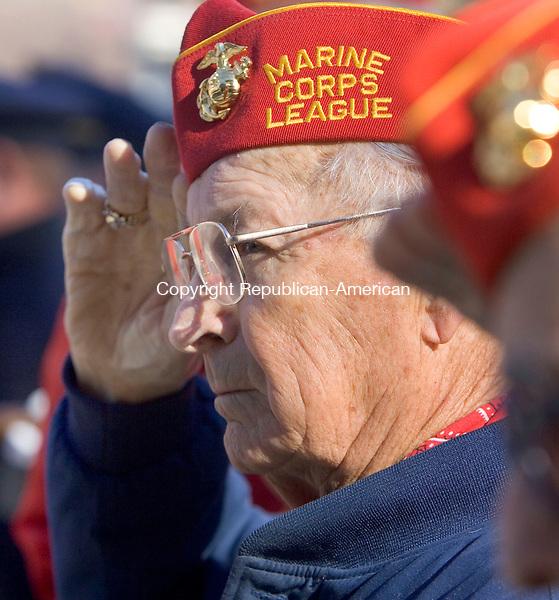 TORRINGTON, CT. 11 November 2010-111110SV05--Ed Zega of Torrington salutes to the National Anthem during the Veterans Day ceremonies in Torrington Thursday.<br /> Steven Valenti Republican-American