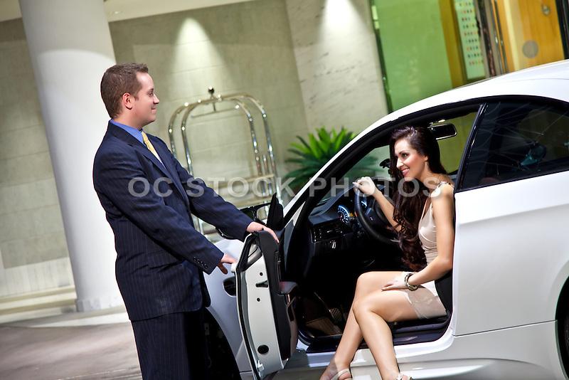 Beautiful Brunette Female Valet Parking Her BMW