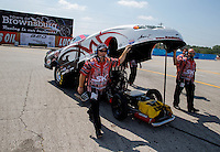 Aug. 30, 2013; Clermont, IN, USA: Crew members for NHRA top alcohol funny car driver Cassie Simonton during qualifying for the US Nationals at Lucas Oil Raceway. Mandatory Credit: Mark J. Rebilas-USA TODAY Sports