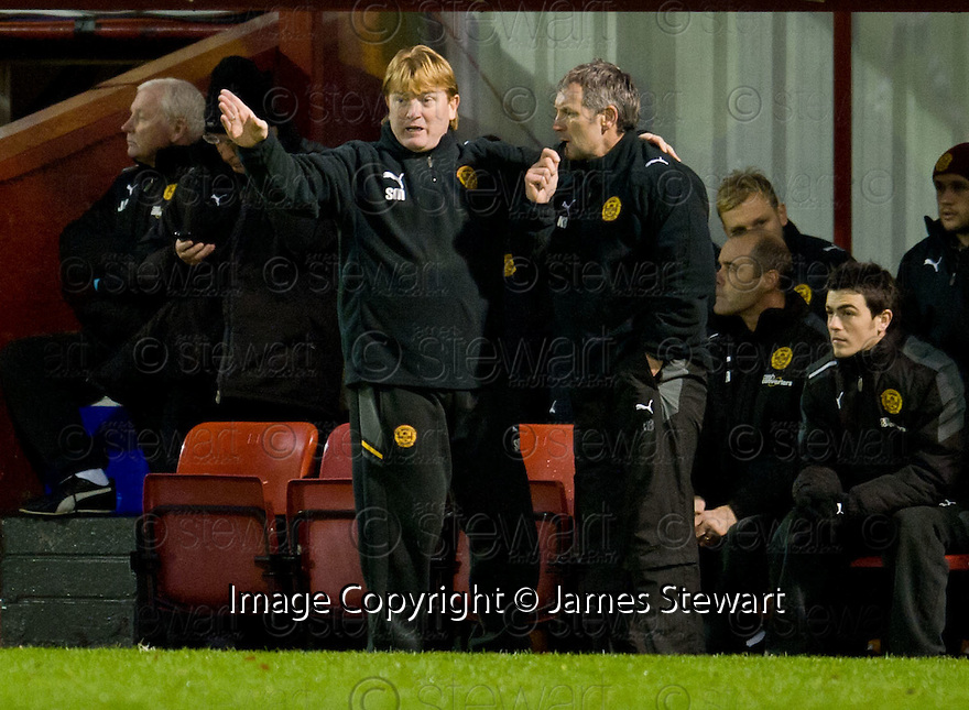 MOTHERWELL MANAGER STUART MCCALL AND ASSISTANT KENNY BLACK...17/12/2011 sct_jsp017_motherwell_v_st_mirren     .Copyright  Pic : James Stewart.James Stewart Photography 19 Carronlea Drive, Falkirk. FK2 8DN      Vat Reg No. 607 6932 25.Telephone      : +44 (0)1324 570291 .Mobile              : +44 (0)7721 416997.E-mail  :  jim@jspa.co.uk.If you require further information then contact Jim Stewart on any of the numbers above.........