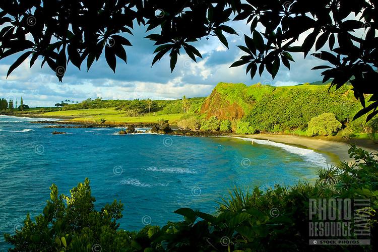 The first light of day strikes Hamoa Beach, Hana, Maui.