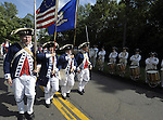 The Windsor Fife and Drum Corp march to the  Windsor Town Hall,  during the 27th annual Windsor Fife and Drum Corps Muster, groups from Connecticut, New York, New Jersey, Rhode Island, were among the groups participating this year, the muster was held on the green in front of Windsor Town Hall. (Jim Michaud/Journal Inquirer) .