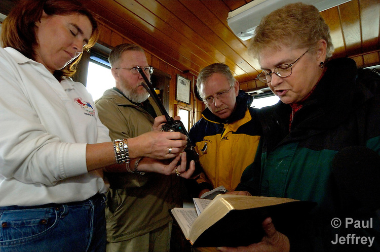The blessing of the crab fleet, which is broadcast over the radio to ships in the Dutch Harbor/Unalaska area as they prepare to begin the crabbing season. Left to right: Unalaska Mayor Shirley Marquardt, United Methodist layman Rick Harwell, Unalaska Christian Fellowship pastor John Honan, Unalaska United Methodist Church pastor the Rev. Dale Kelley.