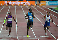 Usain BOLT (centre) of Jamaica (Men's 100m) wins his heat in under 10 seconds during the Sainsburys Anniversary Games Athletics Event at the Olympic Park, London, England on 24 July 2015. Photo by Andy Rowland.