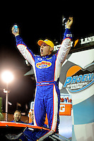 Apr 16, 2009; Avondale, AZ, USA; NASCAR Camping World Series West driver Jason Bowles celebrates after winning the Jimmie Johnson Foundation 150 at Phoenix International Raceway. Mandatory Credit: Mark J. Rebilas-