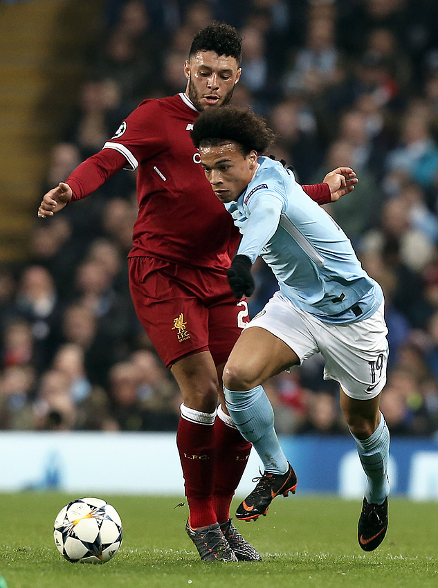 Manchester City's Leroy Sane gets past Liverpool's Alex Oxlade-Chamberlain<br /> <br /> Photographer Rich Linley/CameraSport<br /> <br /> UEFA Champions League Quarter-Final Second Leg - Manchester City v Liverpool - Tuesday 10th April 2018 - The Etihad - Manchester<br />  <br /> World Copyright &copy; 2017 CameraSport. All rights reserved. 43 Linden Ave. Countesthorpe. Leicester. England. LE8 5PG - Tel: +44 (0) 116 277 4147 - admin@camerasport.com - www.camerasport.com