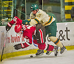 14 December 2013: University of Vermont Catamount Defenseman Nick Luukko, a Junior from West Chester, PA, checks Saint Lawrence University Saint Forward Matt Carey, a Freshman from Hamilton, Ontario, and is subsequently penalized for hitting from behind in the third period at Gutterson Fieldhouse in Burlington, Vermont. The Catamounts defeated their former ECAC rivals, 5-1 to notch their 5th straight win in NCAA non-divisional play. Mandatory Credit: Ed Wolfstein Photo *** RAW (NEF) Image File Available ***