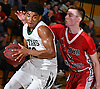 Camren Wynter #12 of Holy Trinity, left, gets pressured by Matthew Lavin #11 of St. John the Baptist during the Nassau-Suffolk CHSAA varsity boys basketball semifinals at LIU Post on Sunday, Feb. 26, 2017. Holy Trinity expanded on a 46-40 halftime lead by outscoring Baptist 32-11 in the third quarter. Holy Trinity went on to win by a score of 90-59.