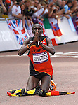 Uganda's Stephen Kiprotich celebrates winning the gold medal in the men's marathon event in the London Olympics on Sunday, August 12, 2012, in London, England. (AP Photo/Margaret Bowles)