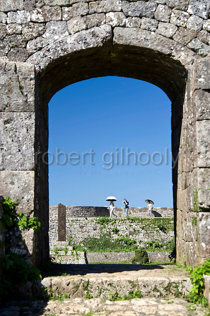 Visitors enjoy the view from the ramparts of the 3rd enclosure of Nakagusuku Castle ruins in KITA-NAKAGUSUKU VILLAGE, Okinawa Prefecture, Japan, on May 20, 2012. Photographer: Robert Gilhooly