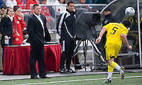 02 May 2009: Toronto FC interim head coach Chris Cummings checks out the competition at BMO Field in a game between the Columbus Crew and Toronto FC. .The game ended in a 1-1 draw...
