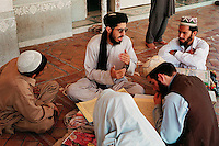 Haqqania Coranic School, Akkora Khattak, Pakistan.More than 80% of the present Taliban leaders went through this Madrassah were more than 2500 students remain in a male-only enclosed world between the ages of 8 and 25 to study Islam.