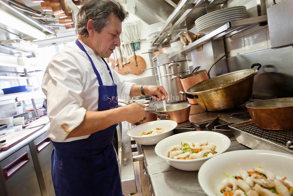 Chef Jacques Maximin prepares dishes in the kitchen of his restaurant Le Bistro de la Marine, Cagnes sur Mer, France, 07 April 2012