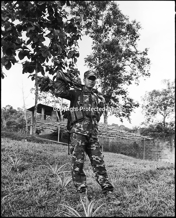 23 year old Jagen Dimasa poses with an M16 assault rifle at the Dibari laison office of the ceasefire terrorist group Dima Halim Daoga (DHD) in Haflong in North Cachar hills of Assam, India.