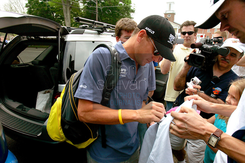 Seven-time Tour de France winner and retired cyclist Lance Armstrong signs autographs for fans before Stage 2 of the 2006 Ford Tour de Georgia pro cycling race. Yaroslav Popovych, a Discovery Channel Pro Cycling Team racer from Ukraine, won the 116.1-mile stage from Fayetteville to Rome.<br />