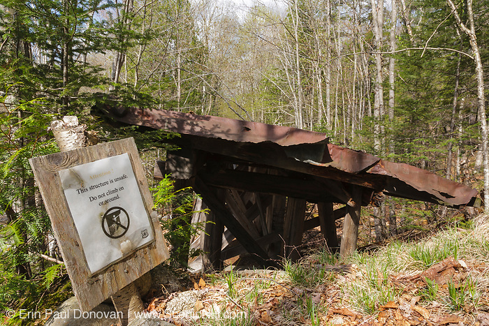 Built in the early 1900s, Trestle No. 16 crosses Black Brook along the old East Branch & Lincoln Railroad (1893-1948) in the Pemigewasset Wilderness of Lincoln, New Hampshire. This photo shows how the trestle looked in May 2009. In 2010, Forest Service dismantled the steel footbridge in the background, and it was not replaced. The sign in the foreground warns of the trestle being an unsafe structure.