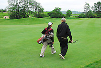 Edgewood's Cody Strang (left) walks with coach Joe Ring during the sudden death playoff round, in which Strang gets 1st place in Division 2 at the 2008 WIAA state golf championship on Tuesday, 6/3/08, at University Ridge in Madison, Wisconsin