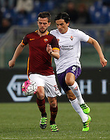 Calcio, Serie A: Roma vs Fiorentina. Roma, stadio Olimpico, 4 marzo 2016.<br /> Roma&rsquo;s Miralem Pjanic, left, is challenged by Fiorentina&rsquo;s Tino Costa during the Italian Serie A football match between Roma and Fiorentina at Rome's Olympic stadium, 4 March 2016.<br /> UPDATE IMAGES PRESS/Riccardo De Luca