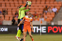 Houston, TX - Sunday June 19, 2016: Nicole Barnhart, Janine Beckie during a regular season National Women's Soccer League (NWSL) match between the Houston Dash and FC Kansas City at BBVA Compass Stadium.
