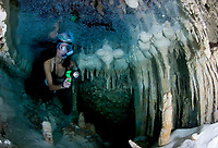 A snorkler explorer the decorations of a cave with fresh water, Bonaire, Netherlands Antilles, Caribbean Sea, Atlantic Ocean, MR