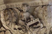 Sculpted capital of St Nichostratus as a sculptor using compasses and tools to carve a frieze, carved 1340-1355, thought to be by Filippo Calendario, 1315-55, from Column 19, depicting 4 crowned saints sculpting, of the ground floor Piazzetta San Marco columns, on the Doge's Palace or Palazzo Ducale, begun 1340 and built in Venetian Gothic style, Venice, Italy. The palace has 2 arcades with 14th and 15th century capitals and sculptures, and a loggia above with a decorative brickwork facade. It was the residence of the Doge of Venice, the supreme authority of the former Republic of Venice, until the Napoleonic occupation in 1797, and is now a museum. The city of Venice is an archipelago of 117 small islands separated by canals and linked by bridges, in the Venetian Lagoon. The historical centre of Venice is listed as a UNESCO World Heritage Site. Picture by Manuel Cohen