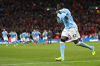 Yaya Toure of Manchester City celebrates after scoring the winning penalty in a shoot out against Liverpool after the Capital One Cup match between Liverpool and Manchester City at Wembley Stadium, London, England on 28 February 2016. Photo by David Horn / PRiME Media Images.