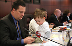 Nevada Assembly Speaker John Oceguera, D-Las Vegas, sits in committee with his son Jackson on Tuesday, May 10, 2011, at the Legislature in Carson City, Nev..Photo by Cathleen Allison