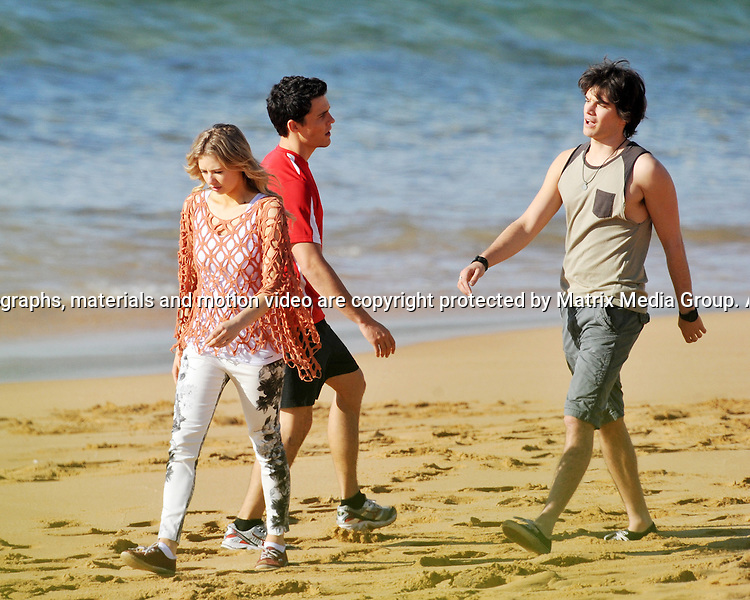 28th July, 2014 SYDNEY AUSTRALIA<br /> EXCLUSIVE <br /> Pictured, Kass Clementi and Andrew Morley cast members of Home and Away doing scenes at Palm Beach  (Summer Bay).<br /> <br /> *No internet without clearance*.MUST CALL PRIOR TO USE +61 2 9211-1088. Matrix Media Group.Note: All editorial images subject to the following: For editorial use only. Additional clearance required for commercial, wireless, internet or promotional use.Images may not be altered or modified. Matrix Media Group makes no representations or warranties regarding names, trademarks or logos appearing in the images.