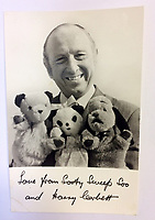 """BNPS.co.uk (01202 558833)<br /> Pic: Hansons/BNPS<br /> <br /> Pictured: Harry Corbett signed photo being auctioned along with the Sooty puppet.<br /> <br /> An iconic old Sooty TV puppet which Harry Corbett gave to a friend has emerged for sale for £1,200.<br /> <br /> The children's show inventor Harry Corbett gifted it to biology teacher Paul Mouncey, from Comrie, Perthshire, Scotland, in the mid-1970s.<br /> <br /> His daughter Tina Stewart, a veterinary receptionist from Dunblane, is now selling the hand puppet with Hanson's Auctioneers, of Etwall, Derbys.<br /> <br /> Mrs Stewart, a veterinary receptionist from Dunblane, Scotland, said: """"We took Sooty along with us and after the show met Richard - who immediately new our puppet was an original."""