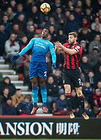 Danny Welbeck of Arsenal & Simon Francis of AFC Bournemouth during the Premier League match between Bournemouth and Arsenal at the Goldsands Stadium, Bournemouth, England on 14 January 2018. Photo by Andy Rowland.