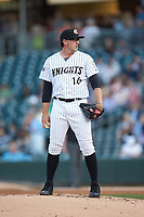 Charlotte Knights starting pitcher Chris Beck (16) looks to his catcher for the sign against the Scranton/Wilkes-Barre RailRiders at BB&T BallPark on April 12, 2018 in Charlotte, North Carolina.  The RailRiders defeated the Knights 11-1.  (Brian Westerholt/Four Seam Images)
