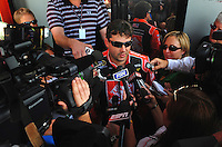 Apr 25, 2008; Talladega, AL, USA; NASCAR Sprint Cup Series driver Tony Stewart is interviewed by reporters during practice for the Aarons 499 at Talladega Superspeedway. Mandatory Credit: Mark J. Rebilas-
