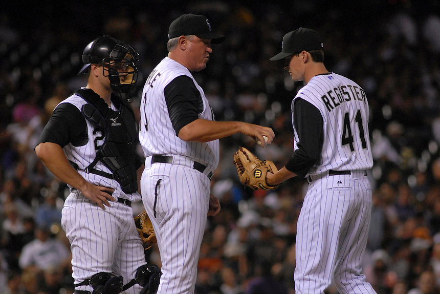 04 August 08: Colorado Rockies manager Clint Hurdle, center, hands a ball to pitcher Steven Register in his major league debut during a game against the Washington Nationals. Also pictured is catcher Chris Iannetta. Register faced one batter and struck him out. The Nationals defeated the Rockies 9-4 at Coors Field in Denver, Colorado. FOR EDITORIAL USE ONLY. FOR EDITORIAL USE ONLY