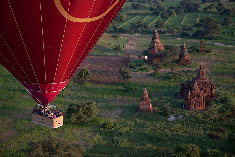Hot air balloon drifts over temples on plains of Bagan,Burma
