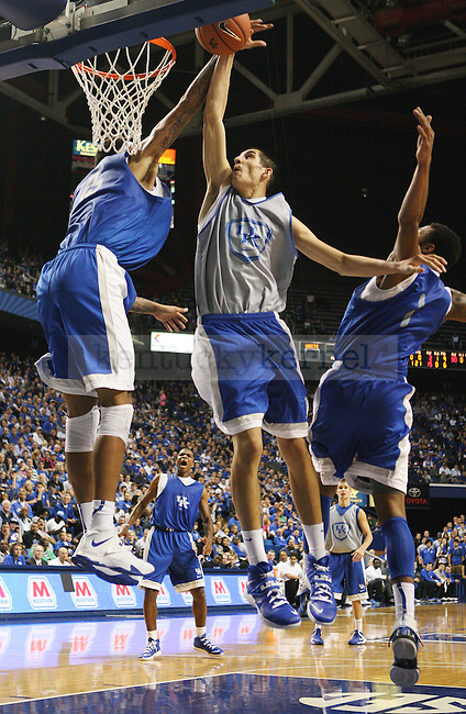 Kentucky Wildcats forward Derek Willis (35) jumps to shoot the ball against Kentucky Wildcats forward Willie Cauley-Stein (15) and Kentucky Wildcats guard James Young (1) during the second half of the Blue-White scrimmage at Rupp Arena in Lexington, Ky., on Tuesday, October 29, 2013. Photo by Tessa Lighty | Staff