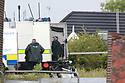 Police and Army Bomb Disposal trucks are seen inthe grounds of St. Coleman's Cemetery, Lurgan, Monday, June 17th, 2019. (Photo by Paul McErlane for the Belfast Telegraph) Army Bomb Disposal team are seen inthe grounds of St. Coleman's Cemetery, Lurgan, Monday, June 17th, 2019. (Photo by Paul McErlane)