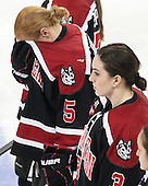 Kelly Wallace (NU - 5), Katie MacSorley (NU - 3) - The Boston College Eagles defeated the Northeastern University Huskies 3-0 on Tuesday, February 11, 2014, to win the 2014 Beanpot championship at Kelley Rink in Conte Forum in Chestnut Hill, Massachusetts.