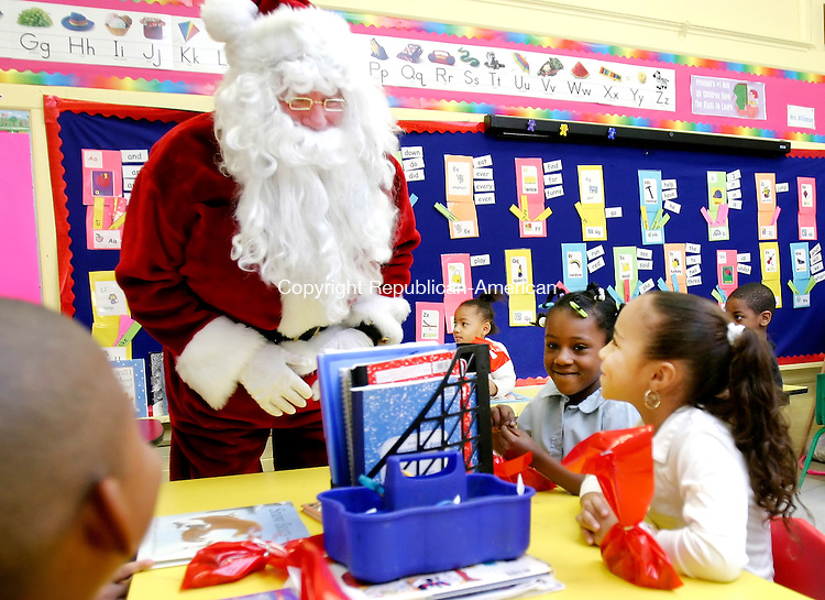 WATERBURY, CT. 21 December 2007-122107SV12--Santa visited students to pass out gifts at Woodrow Wilson School in Waterbury. The local company from Beacon Falls, NEJ Inc., gave every student at the School a gift Friday.<br /> Steven Valenti Republican-American
