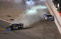 Jul. 5, 2008; Daytona Beach, FL, USA; NASCAR Sprint Cup Series driver Denny Hamlin (11) and Ryan Newman (12) crash during the Coke Zero 400 at Daytona International Speedway. Mandatory Credit: Mark J. Rebilas-