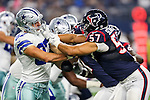 Dallas Cowboys tight end Geoff Swaim (87) and Houston Texans linebacker Brennan Scarlett (57) in action during the pre-season game between the Houston Texans and the Dallas Cowboys at the AT & T stadium in Arlington, Texas.